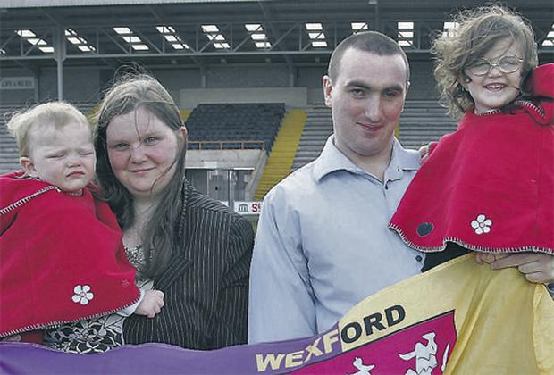 The Wexford supporting Dunne family shown pictured in April 2005 in Wexford Park. Adrian, his wife Ciara, and their daughters Shania (14 months) and Lean (3)