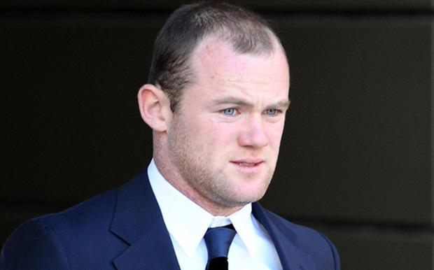Wayne Rooney leaves Manchester Civil Court, where he gave evidence in court as he fights a £4.3m lawsuit. Photo: PA