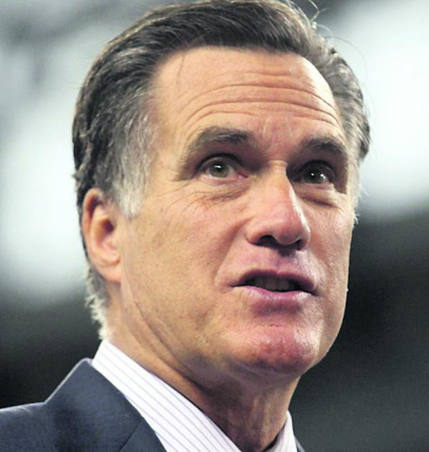Republican presidential candidate Mitt Romney addresses the Detroit Economic Club during a campaign stop at Ford Field in Detroit
