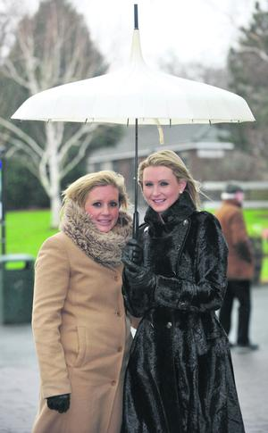 Danielle McSorley, from Dublin, right, and Niamh Flynn from Galway at the last day of the Leopardstown races Picture credit; © Damien Eagers 29/12/2011