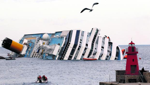 A view shows the Costa Concordia cruise ship that ran aground off the west coast of Italy, at Giglio island January 15, 2012.Teams were painstakingly checking thousands of rooms on the cruise ship for nearly 40 people still missing, more than a day after the huge vessel foundered and keeled over with more than 4,000 on board, killing at least three people and injuring 70. REUTERS/Max Rossi (ITALY - Tags: DISASTER MARITIME TRANSPORT)