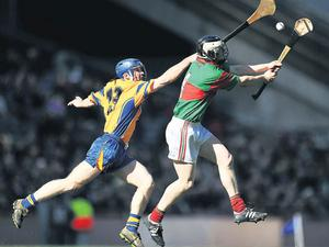 Portumna's Damien Hayes (left) battles it out with Birr's Michael Verney during the All-Ireland Club Senior Hurling Championship final.