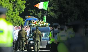 Mourners attend the funeral of Real IRA member Alan Ryan at the Church of the Holy Trinity in cemetery in Balgriffen, north Dublin. PRESS ASSOCIATION Photo. Picture date: Saturday September 8, 2012. Photo credit should read: Julien Behal/PA Wire