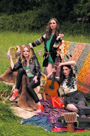 Left to right: Danielle wears faux-fur crop jacket, €25; green crop top, €5; heart pendant, €5; leather trousers, €19, and orange sandals, €13; Aoife wears cardigan, €18, and playsuit, €7; Grace wears hoop earrings, €3; dress worn as top, €15; belt, €4; ring, €3, and skirt, €11