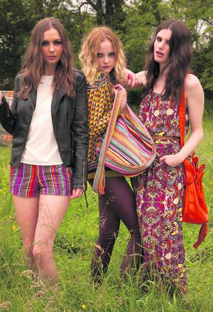 From left Aoife wears pleather jacket, €25; top, €11, and shorts, €9; Danielle wears shirt, €15; pleather trousers, €21, and printed bag, €5; Grace wears maxi dress €13, orange bag €13 and ring €3.