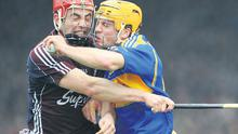 Galway's John Lee and Tipperary's James Woodlock get to grips with each other at the Gaelic Grounds, Limerick, yesterday
