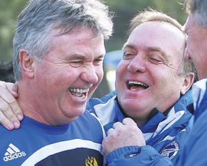 Russia boss Guus Hiddink, left, shares a joke with Zenit St Petersburg's coach Dick Advocaat at a training session with the Russian national team in Turkey yesterday