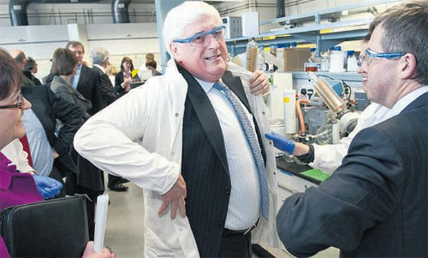 Education Minister Batt O'Keeffe dons a lab coat as he's shown round the newly renovated laboratories in the Kane Science building at University College Cork , by Professor Anita Maguire and President of UCC Dr Michael Murphy