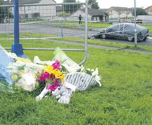 Flowers mark the spot where a man was shot dead in Moyross where the vast majority of decent residents are paying too high a price for the activities of the gangs