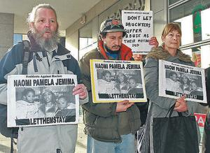 Members of Residents Against Racism show their support for Pamela Izevbekhai during her court battle last year