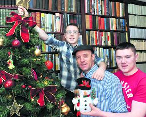 Michael Healy-Rae putting up the Christmas tree with sons Jackie and Kevin following his health scare