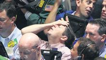 Traders work in the product options pit at the Mercantile Exchange in New York yesterday