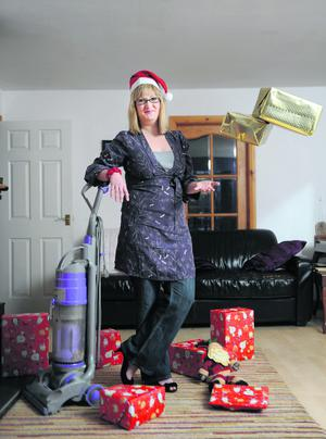 17/12/2011. Pacemaker Belfast. Heidi Scrimgeour and her Christmas wish, a new vacuum cleaner. Picture Charles McQuillan/Pacemaker.