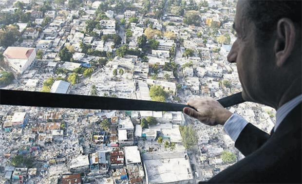 French President Nicolas Sarkozy observes the damaged city of Port-au-Prince, Haiti, from a helicopter yesterday