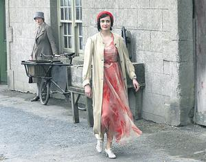 Actress Eva Green takes a stroll through Redcross, Co Wicklow, during a break from filming for her new movie 'Cracks'