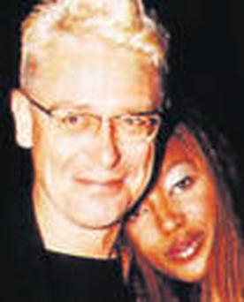 One love? Naomi with one of her many A-list squeezes, U2?s Adam Clayton