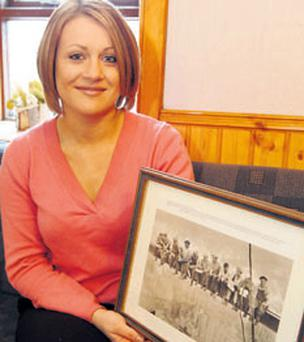 Cathy Whelan in Whelan's pub in Shanaglish, where the historic picture and letter were sent.