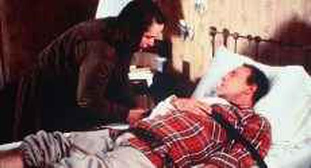 Kathy Bates and James Caan in a scene from the film adaptation of Stephen King's novel Misery