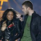 Janet Jackson reacts after fellow singer Justin Timberlake ripped off one of her chest plates at the end of their Super Bowl performance.
