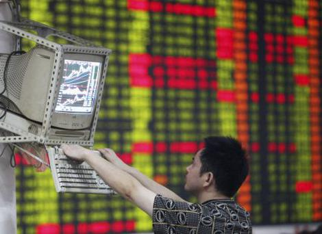 A man checks the boards as the Chinese market ignored the US sub-prime mortgage crisis. Reuters