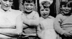 Jean McConville (left) with three of her children before she disappeared in 1972. The widowed mother of 10 young children was abducted and murdered for no other reason than that she was a Protestant living in a Catholic enclave.