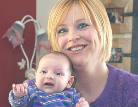 Patricia Keane with her son Ryan, who was born in the car en route to hospital in Limerick.