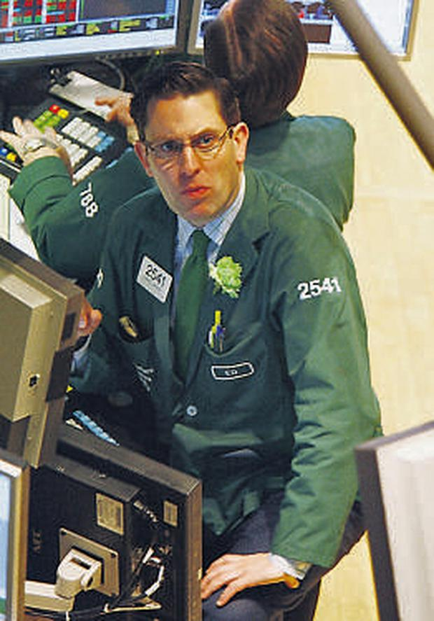A concerned looking trader on the floor as the New York Stock Exchange takes a tumble