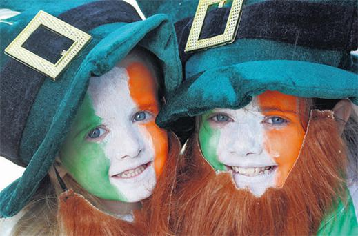 Sisters Aine (4) and Aoife McGarvey (9) at the parade at Gweedore in Co Donegal
