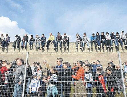 Supporters watch yesterday's Monaghan v Meath game from various vantage points at Scotstown yesterday