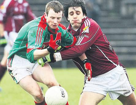 Mayo's Colm Boyle battles it out with Matthew Clancy at McHale Park, Castlebar, yesterday