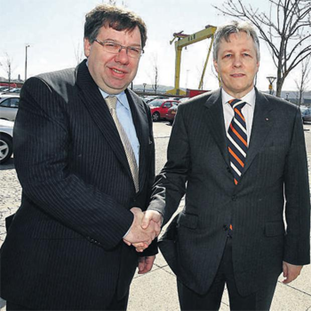 Brian Cowen shakes hands with new DUP leader Peter Robinson in Belfast