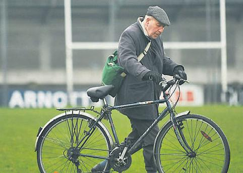 A man walks his bicycle across the pitch after the game between Dublin and Meath at Parnell Park yesterday