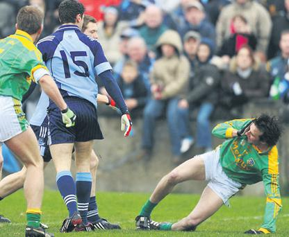 Meath's Shane McAnarney falls to the ground as Dublin and Meath players become involved in the melee which marred Sunday's game at Parnell Park