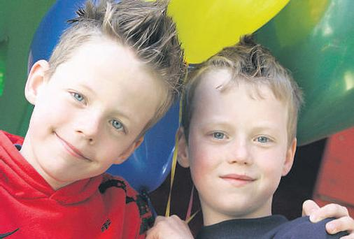 Twins Michael and Padraic Crawford (8) enjoy Park Academy's after-school care