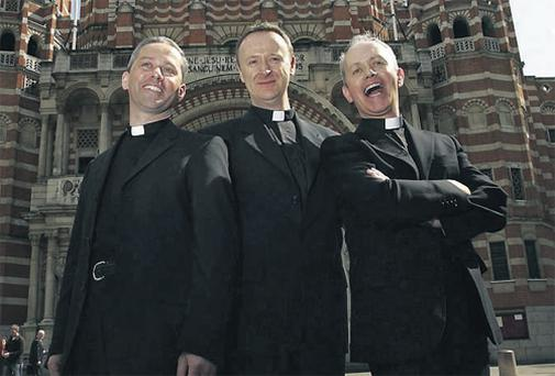 Spreading the message: singing priests Fr Martin O'Hagan, Fr David Delargy, and Martin's brother, Fr Eugene O'Hagan, at a photocall in front of Westminster Cathedral in London last week when they announced their recording deal with Sony BMG