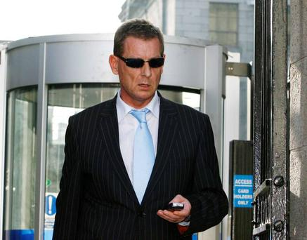 John O'Brien leaves court yesterday where he claimed he was about to sign over the family home to his wife after an assault