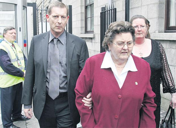 Waterford bus driver John O'Brien leaving the court with his mother, Sheila, and sister, Jackie, after being found not guilty yesterday