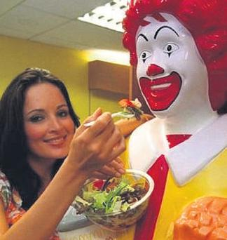 Model Andrea Roche shares a salad with Ronald McDonald