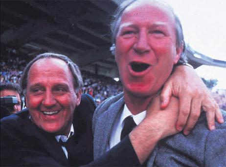 Republic of Ireland manager Jack Charlton (right) and assistant manager Maurice Setters celebrate their team's victory over England in Stuttgart during Euro 88