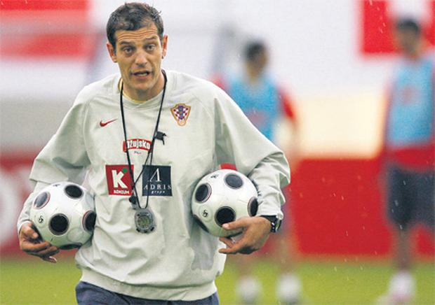 Slaven Bilic, the Croatian coach keeps the balls during a practice session in the Bad Tatzmansdorf stadium in Austria before the European Championships