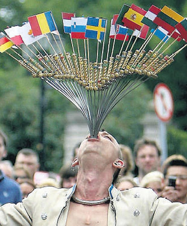Australian sword swallower 'The Space Cowboy' attempted to swallow 27 swords decorated with the flags of each of the countries in the EU to mark today's referendum on the Lisbon Treaty