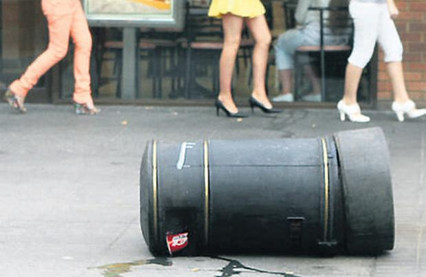 An overturned bin at The Square shopping centre in Tallaght yesterday. The Dublin suburb has been branded a litter blackspot