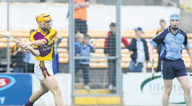 Wexford's Eoin Quigley converts the late equalizing point against Dublin in Nowlan Park last Saturday.