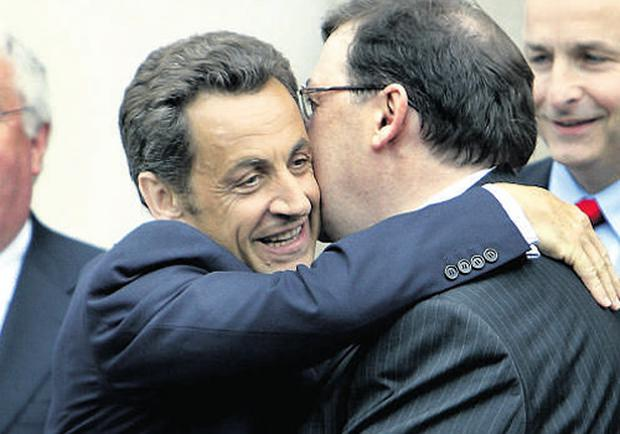 Taoiseach Brian Cowen embraces French President Nicolas Sarkozy during a news conference at Government Buildings yesterday