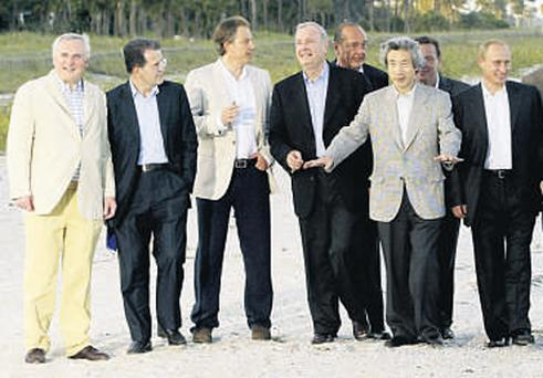 Former Taoiseach Bertie Ahern lets the side down with his canary-yellow interpretation of smart-casual during a walk with world leaders at the 2004 G8 summit
