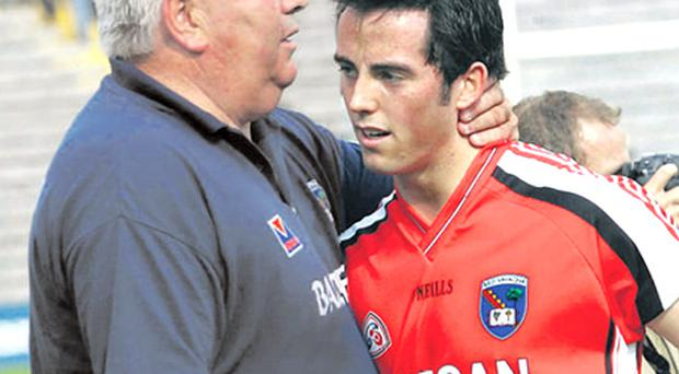 Former Armagh boss Joe Kernan consoles his son Aaron after their All-Ireland qualifier defeat to Derry last year