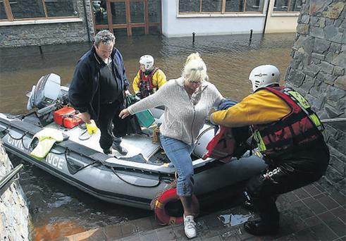 Locals living in apartments by the Barrow had to be brought to work by Civil Defence inflatable boats after floods swept Carlow Town