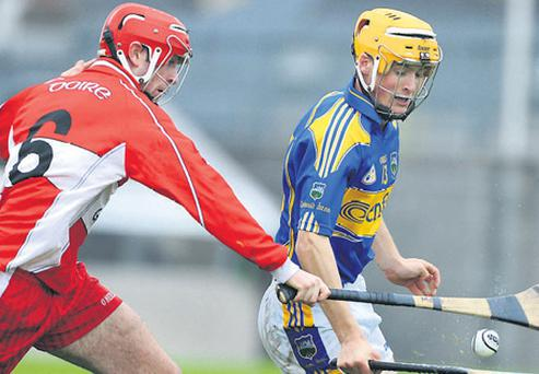 Mark Craig of Derry and Tipperary's Pa Bourke have eyes only for the sliotar as they battle it out at Cusack Park