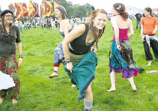 Rebecca Clarke, from Cardiff dances with friends to Kila at Electric Picnic