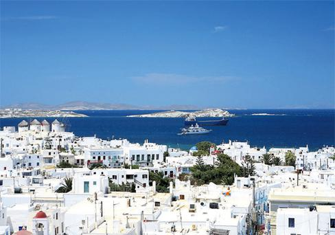 Greek odyssey: The whitewashed buildings of Mykonos Town are full of narrow lanes that are home to tucked-away bars and boutiques